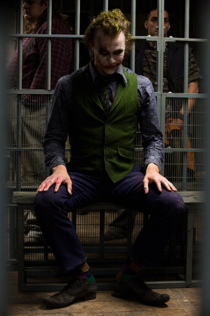 Heath Ledger as The Joker seated in jail cell.jpg