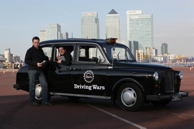 Dr James Brighton and Colin Murray with remote controlled black cab-1.jpg